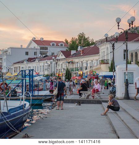 BALAKLAVA CRIMEA. UKRAINE - JULY 25 2010: Tourists on the waterfront