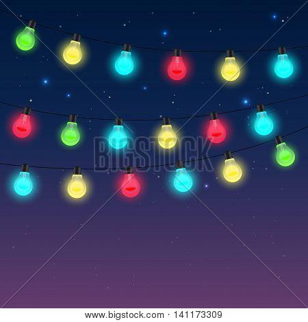 Garlands Of Varicoloured Light Bulbs Against Night Starry Sky