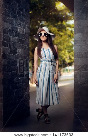 Woman in Summer Dress with Stripes Wearing Sunglasses and Hat