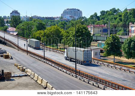 truck with containers in seaport, cargo shipping and transportation concept