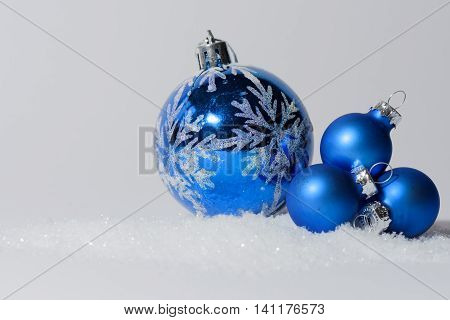 Glass ball Christmas ornament with bow. Christmas decorations in blue color