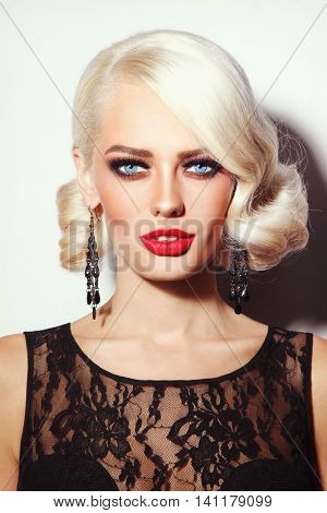 Portrait of young beautiful sexy platinum blonde woman with stylish hairdo and red lipstick
