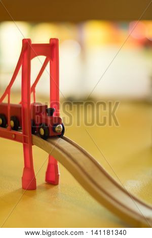 Red Wooden Toy Train Crossing Bridge