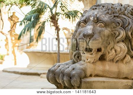 Stone lion sculpture guarding the Grand Masters Palace Valletta Malta Europe.