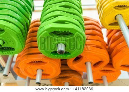 Closeup image of color dumbbells in modern gym