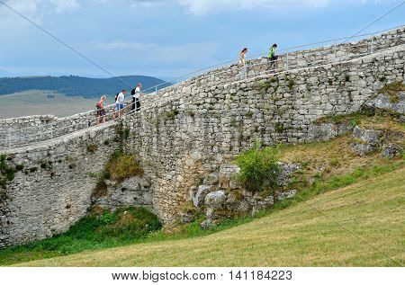SPISSKY HRAD SLOVAKIA - AUGUST 18 2015: Tourists on ruins castle Spissky Hrad Slovakia.