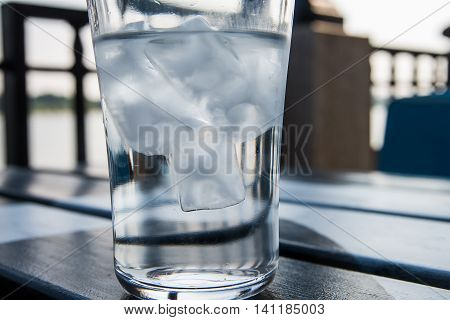 Glass of ice cubes on a table at cafe