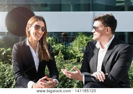 Cheerful business people on break outdoors, horizontal image,