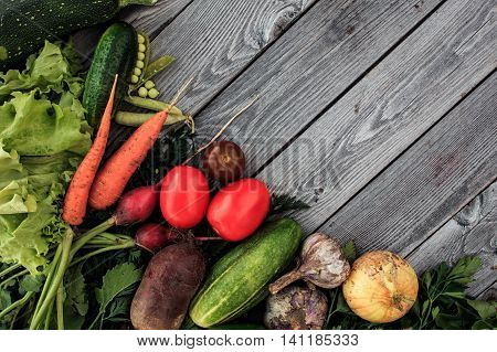 Young Spring Vegetables On Wooden Chalkboard From Above. Carrots, Tomatoes, Zucchini, Leek, Radish,