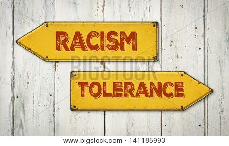 Direction Signs On A Wooden Wall - Racism Or Tolerance