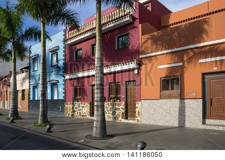 PUERTO DE LA CRUZ, TENERIFE, CANARY ISLANDS - JANUARY 14, 2014: Beautiful colorful buildings in the old town of Puerto De La Cruz, one of the most popular touristic towns on Tenerife, Canary islands, Spain