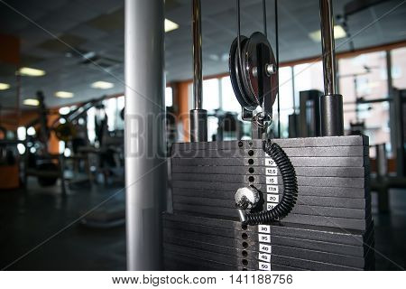 Closeup image of weights for trainer in modern gym