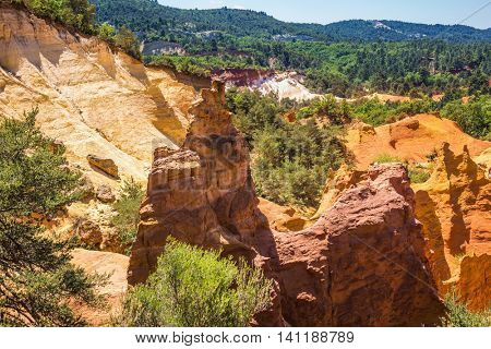 Picturesque orange and red hills. Reserve - quarry for ocher mining. Languedoc - Roussillon, Provence, France