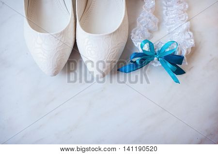 close up photo of beautiful bride's shoes