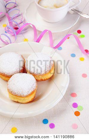 three doughnuts on plate confetti and streamer