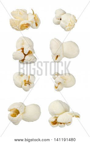Single popcorns isolated on white. Extra large macro set. Extreme close up. Junk food, dessert, snack concept.