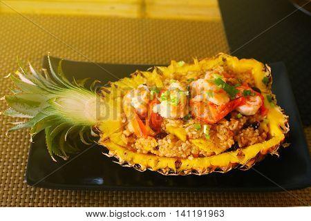 thai food restaurant stuffed with rise shrimps prawn raisin fruit pineapple close up photo on the table