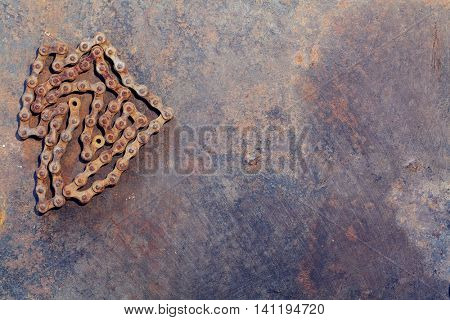 Old rust chain on metal work bench. Top view with copy space