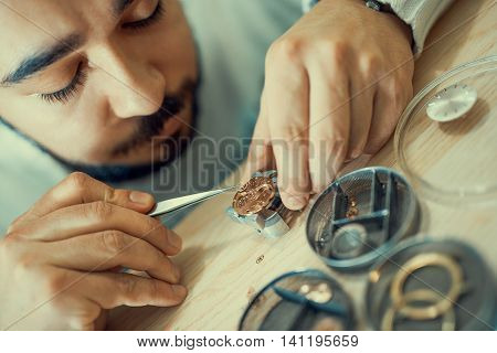 Close up portrait of a watchmaker at work