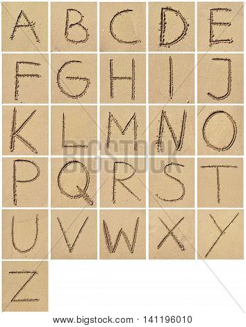 Alphabet drawing or writing in the sand. Arrangement of letters in the sand.