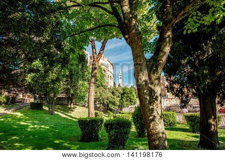 Park near the amphitheatre with view on Curch of St. Anthony in Pula, Croatia