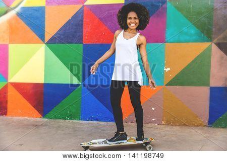 Afro girl skateboarding
