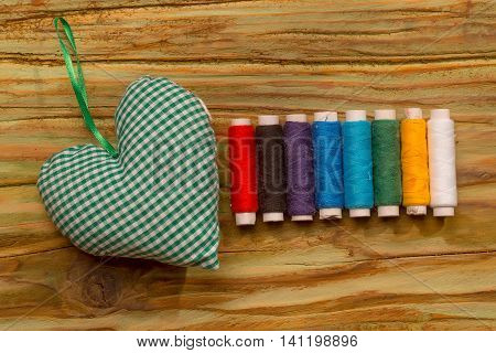 Bobbins Of Thread And Green Decorative Heart