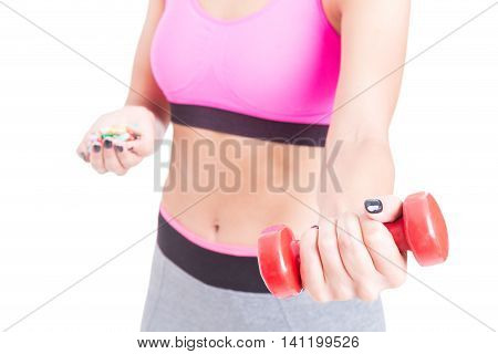 Selective Focus Of Girl Choosing Dumbbell Over Pills