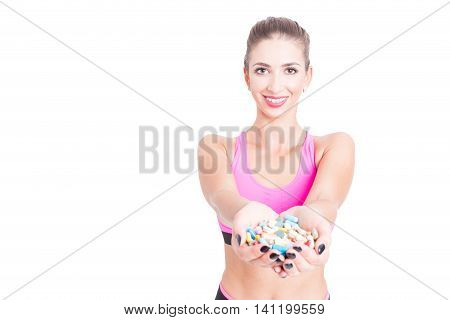 Female At Gym Holding Bunch Of Pills Or Supplements