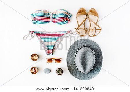 female summer clothes and accessories collage on white flat lay top view