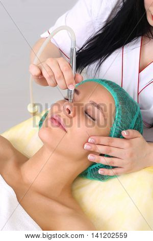 Procedure of Microdermabrasion. Mechanical Exfoliation, diamond polishing. Model, close-up. Cosmetological clinic. Medical equipment. Healthcare clinic cosmetology