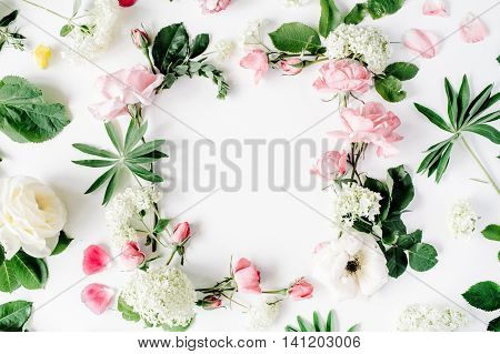 flat lay frame with pink and white roses branches leaves and petals isolated on white background. top view