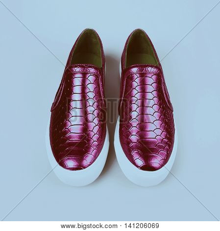 pair of new purple shoes in grey background