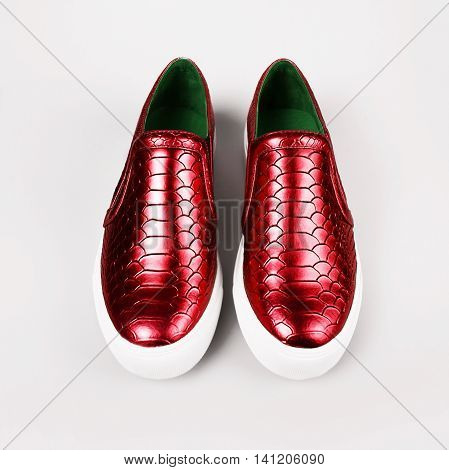 pair of new red shoes over grey background