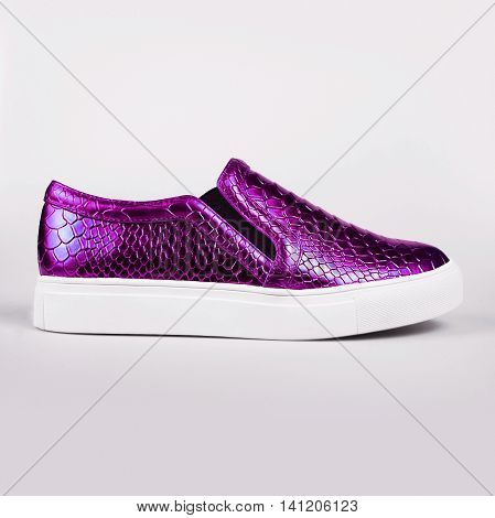 pair of new purple shoes over grey