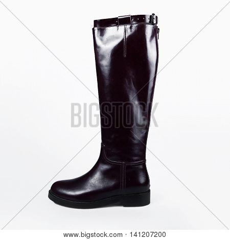stylish female black boots over white background