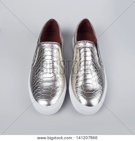 silver shoes Italian shoes in grey background