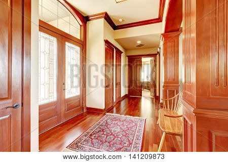 Bright Foyer In Luxury Home With Hardwood Floor.