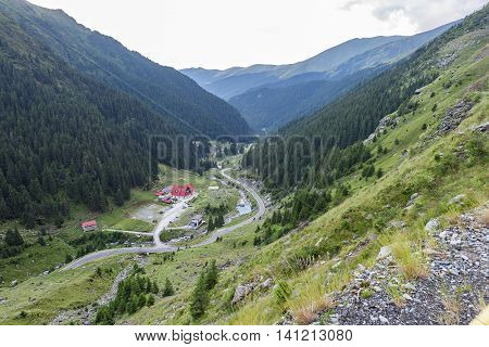 Photo of capra peak and famous winding road in fagaras mountains at sunset Romania.