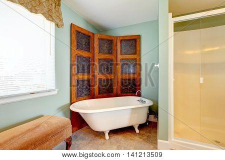 Antique Bathroom Interior With White Bath Tub