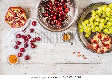 Different fruit and spices on the white wooden table. Concept of oriental fruits horizontal