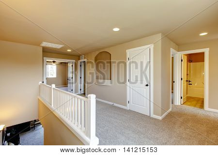 Upstairs Hallway In Big House With Beige Interior Paint.