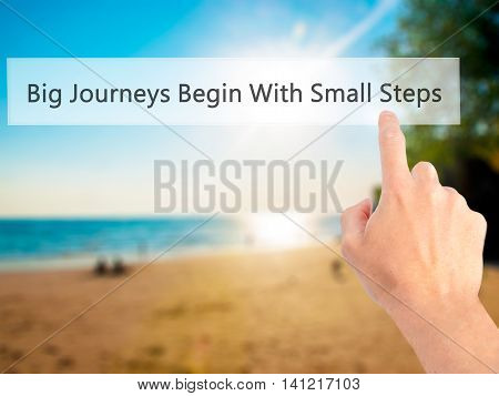 Big Journeys Begin With Small Steps - Hand Pressing A Button On Blurred Background Concept On Visual