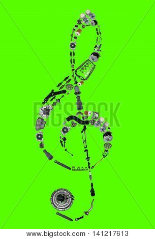 Treble clef assembled from new auto, spare parts. Spare parts for shop, aftermarket, OEM. Treble clef with parts. New spare parts for shop. Auto parts for car isolated on green screen, chroma key