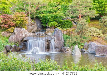 Japanese Garden Beautiful In Nature With Little Waterfall.