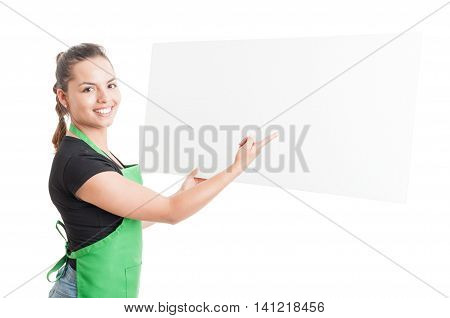 Cheerful Beautiful Seller Pointing At Blank Cardboard