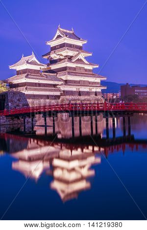 Matsumoto Castle (matsumoto-jo) Historic Landmark At Night With Beautiful Reflection In Water.