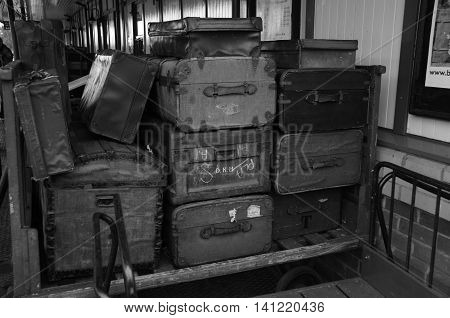 A view of vintage suitcases and luggage at an old railway platform