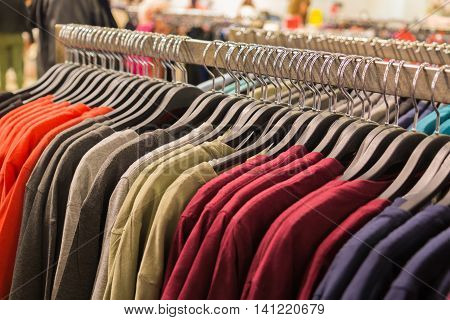 Clothes Hanging On A Rack In A Shopping Mall.