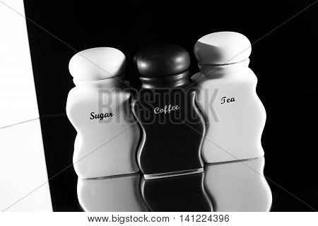Capacities for condiment spices - Sugar coffee tea a set on a black and white background.